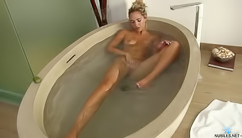 Awesome girl having appetitive boobs is satisfying herself passionately in the shower. She is fingering her juicy twat and massaging breasts.